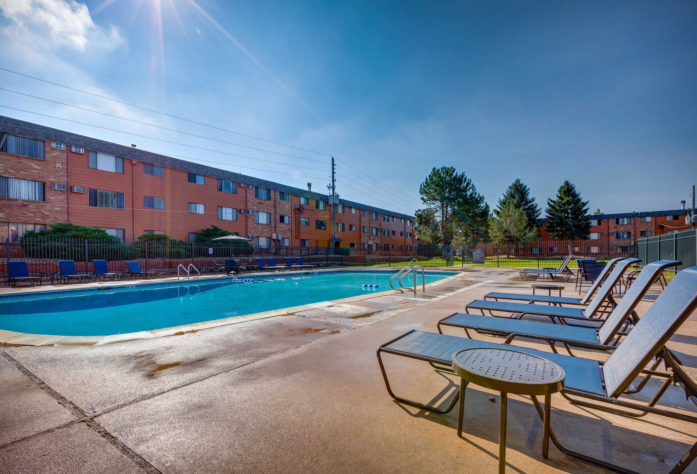 Vista Park - Apartment living on a 5-acre park-like setting with giant evergreens, bushes and green lawns right in the city of Aurora
